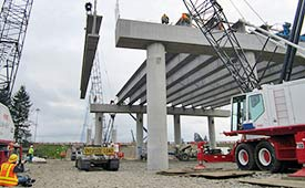 Maneuvering a girder onto the future NE 139th Street Interchange